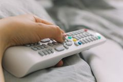 Free Hand Holding TV Remote Stock Photography - 110565222
