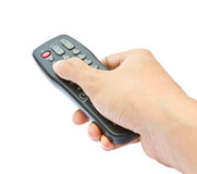 Hand holding TV remote Royalty Free Stock Photo