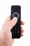 Hand holding TV remote control Royalty Free Stock Photo
