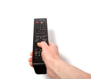 Hand holding tv remote control. Isolated on the white background Stock Photos