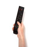 Hand holding tv remote control. Isolated on the white background Stock Photography