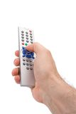 Hand holding a TV remote control Royalty Free Stock Photography