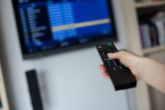Hand holding tv remote control Royalty Free Stock Photos