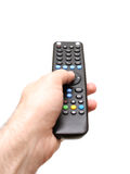 Hand holding a TV remote Royalty Free Stock Image