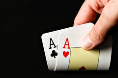 Hand holding two aces. Stock Image
