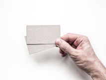 Hand holding two business cards on the white wall, Mockup Stock Photography