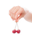 Hand holding  two cherries on white background Royalty Free Stock Image
