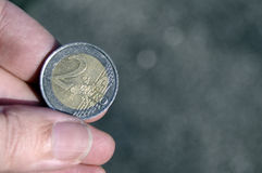 Hand holding a two euro coin Royalty Free Stock Photography