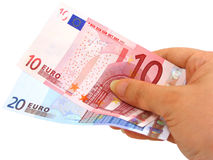 Hand holding two euro notes (clipping path included). Female hand holding two euro notes isolated on white with clipping path Stock Photo