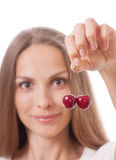 Hand holding two fresh cherries Royalty Free Stock Photo