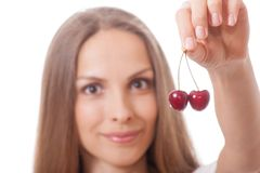 Hand holding two fresh cherries Royalty Free Stock Photography