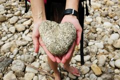 Hand Holding Two Heart Shaped Stones royalty free stock photo