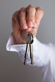 Hand holding two keys Stock Photos