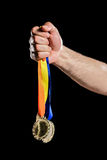 Hand holding two olympic gold medal Stock Photo