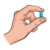 Hand holding two piece blue gelatin capsule by two fingers Stock Photos