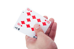 Hand holding two playing cards isolated Royalty Free Stock Photo