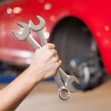 Hand Holding Two Wrenches Stock Photos