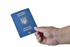 Hand holding Ukrainian biometric passport isolated on white background Stock Photos