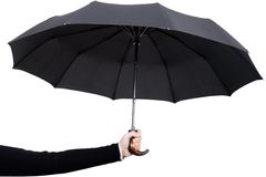 Hand holding umbrella Stock Photos