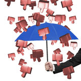 Hand holding umbrella to prevent 3D thumbs down Stock Images