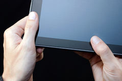Hand Holding Unlit Tablet, Close Royalty Free Stock Photography