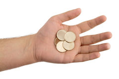Hand Holding Unmarked Gold Coins Stock Photo