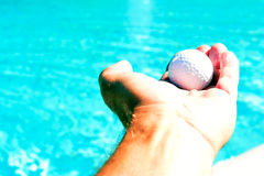 Hand holding up ball Stock Photography