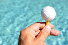 Hand holding up ball Royalty Free Stock Photos