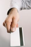 Hand holding up a credit card Royalty Free Stock Photo