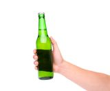 A hand holding up a green beer bottle. Without label over a white background vertical format Stock Images