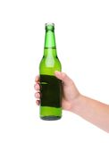 Hand holding up a green beer bottle Stock Images
