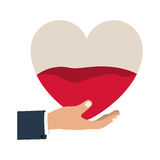 Hand holding up a heart bag with blood Royalty Free Stock Image
