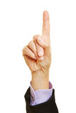 Hand holding up index finger Stock Photo