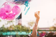 Hand holding up rope of greeting balloon for special event or bi. Rthday party. Happiness and celebration party concept. Friendship congratulation and happy Stock Photo