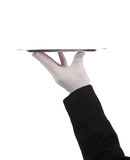 Hand holding up silver tray Royalty Free Stock Image