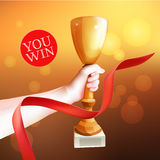 Hand Holding Up Trophy. Vector Winner Cup Illustration. Red ribbon. Royalty Free Stock Photography