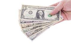 Hand Holding US Dollar Bills in Various Denomination Stock Image