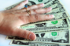 Hand holding US dollars isolated on the white Royalty Free Stock Photos