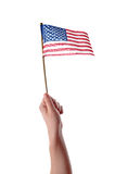 Hand Holding USA Flag. Hand holding American flag in mid air isolated on white background Stock Photos
