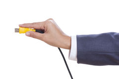 hand holding USB cable. Stock Photo