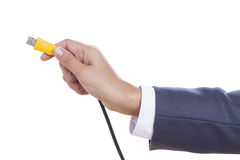 hand holding USB cable. Stock Photos