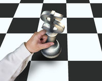 Hand holding USD symbol piece playing Chess on table Royalty Free Stock Image
