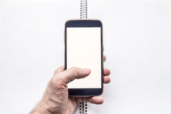 Hand holding and using mobile smartphone Stock Photography