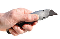 Hand Holding Utility Knife Stock Images