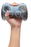 Hand holding video game controller. Isolated on white background Stock Photos
