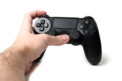 Hand holding video game controller isolated on white background Stock Image