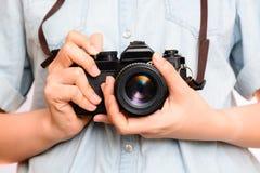 Hand holding vintage camera Stock Image