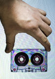 Hand holding vintage cassette tape Stock Photo