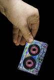Hand holding vintage cassette tape Royalty Free Stock Images