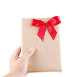 Hand holding vintage gift with red ribbon. On white background Royalty Free Stock Photos